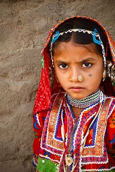Portrait of a girl from the Marwada Meghwal Harijan tribe wearing traditional clothing in the village of Hodka, Gujurat, India