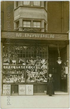 Meta Dowden's shop at 652 Old Kent Road, dealing in confectionery, toys and fancy goods. Meta Whitting Dowden was born in 1886 in North Nibley, Gloucestershire. It is very likely that the lady posing in front of the shop is Meta herself. Victorian London, Vintage London, Old London, Vintage Shops, East London, 1920 London, London History, British History, London Photography