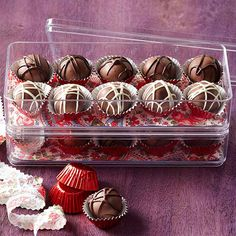 Triple-Chocolate Truffles--Plastic boxes, candy cups, and festive fabric are all you need to package these luscious chocolate truffles. It's really all about the luscious milk chocolate-covered truffles inside, anyway.