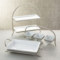 Shop Cambridge Baking Dish with Rack. Clean lines in white porcelain and satin metal make a simply sophisticated oven-to-table statement. The rectangular baker rests neatly in a graceful, footed metal stand with arched handles. Crate And Barrel, Vase Deco, Tiered Server, Tissue Paper Flowers, Ideas Geniales, Kitchen Items, Unique Furniture, Serving Platters, White Porcelain