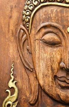 Buddha' face, carving from teak wood in Thai style | Stock Photo ...