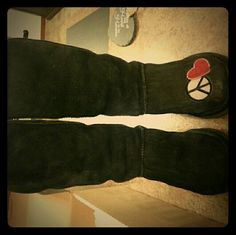 Classic Tall UGG love & peace design Classic tall uggs in black, some wear but plenty of life left! Love & peace patchwork. Has some sticky on toe of left boot by patch, not very noticeable, however??purchased at Victoria's secret UGG Shoes Winter & Rain Boots