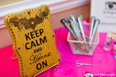 Keep Calm and Henna On!  Place signs with pretty henna designs on tables as centerpieces or on a small table near the stage. | Jamie Howell Photography via Marharani Weddings