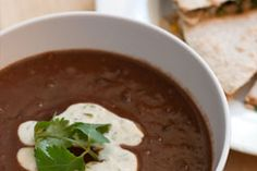 """Black Bean Soup + Cilantro-Lime Yogurt Crema  """"This recipe for Black Bean Soup + Cilantro-Lime Yogurt Crema is hearty, creamy, satisfying, chock full of vegetables and not an ounce of guilt.  http://lickmyspoon.com/recipes/black-bean-soup-cilantro-lime-yogurt-crema/"""""""