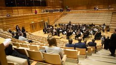Guests watch an open rehearsal with the University Concert Band in the afternoon.