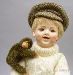 Heubach Bisque Laughing Character Doll and a Steiff Chimp | Sale Number 2419, Lot Number 1030 | Skinner Auctioneers