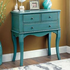 Add antique elegance to your home without compromising floor space. This gorgeous storage piece is supported upon elegant cabriole legs while curved aprons and dark knobs adorn the front face. - Vinta