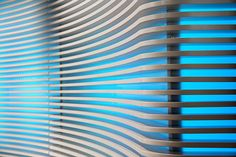 MDF slats painted white with backlit acrylic blue panel (used in Big Ten Network Broadcast Studio)
