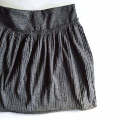 """Banana Republic Grey Cotton Skirt Insanely soft. You'll wear this everywhere. Your significant other/bff/cat/roommate will have to drug you to get it off of you cause I guarantee you'll never want to take it off. So, be wary of leaving your drink sitting around. Ribbed/pleating detail on skirt. Zip close. Marked size 0 but runs large IMO. I'm a 3/26 and I can fit it high waisted just fine, but without extra room. Bottom hem is slightly rolled up, design wise.  Waist: 26""""  //   Length: 17""""…"""