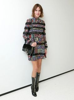 Alexa's sassy patent boots are the perfect antidote to her flippy girlie minidress.