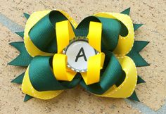Large Stacked Bottlecap Boutique Bow with Spikes Visit www.facebook.com/PrincessWiggleBottom to view more!