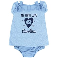 Our Tarheels Baby Girl My First Love Outfit will surely to melt hearts when your little one puts it on! The 100% poly/rayon blend athletic fabric Onesie dress features official UNC team colors and screen-printed logos. The shoulders are decorated with sweet, ruffle bows. Comes in UNC infant sizes 0-3m, 3-6m, and 6-12m.