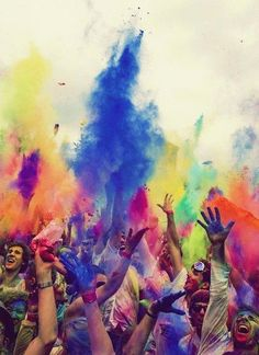 this is a good picture as it shows people having fun with bright colours this would be good on a page about festivals