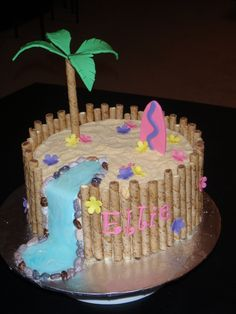 Luau Cake - Found a cake like this online, I can't remember who it was by though, sorry.  It's a 10in cake frosted in buttercream.  The I stuck the cookies all around the sides (attaching with frosting), and covered the top with crushed graham crackers.  The details are done in fondant, and the water fall is fondant with piping gel over it.