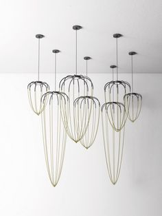Alysoid, air and light Alysoid, the first project by Japanese designer Ryosuke Fukusada for Axo Light, is a collection of aluminium hand crafted suspension lamps characterised by precious, draped chains that define the