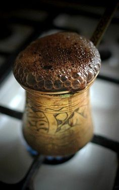 Coffee in an old copper coffee pot. I can feel this aroma. So good!: