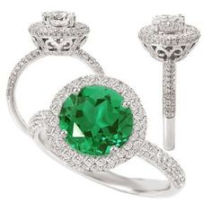 """For the bride who doesn't want something blue, but something green! This official title of this ring is """"18k Chatham 7.5mm round emerald engagement ring with diamond halo."""" This is an eco friendly engagement ring as the emerald is lab created. (Better for the earth!) The Chatham emerald is surrounded by a halo of diamonds that are sure to wow you. """"The ring features 172 G-H color SI1-SI2 clarity natural diamond accents weighing .50 cttw. The shank is 2.5mm wide with a 4mm high gallery with…"""