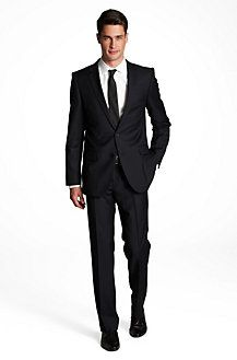 Black Suits for the guys. Husband would be wearing a white pocket scarf while groomsmen would wear a black pocket scarf.