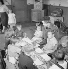 THE LIBERATION OF BERGEN-BELSEN CONCENTRATION CAMP, JUNE 1945. Miss S J Reekie, a British trained nurse and child welfare specialist works with the very young children in the kindergarten set up at Belsen after the liberation of the camp. All the children in the photograph were orphans.