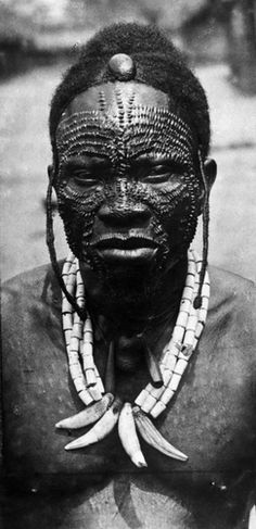 Africa | The chief of the Bapotos tribe shows his facial tribal markings.  DR Congo.  ca. 1919 | © E. Torday / National Geographic Society