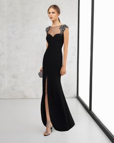 Long crepe cocktail dress with beadwork appliqués on shoulder and sheer tulle front and back necklines. Available in navy blue, black, silver, coral, cobalt, green, blue and red. 2018 ROSA CLARA COCKTAIL Collection.