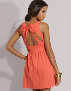 adorable! Love the open back, the bow, the melon color! So cute
