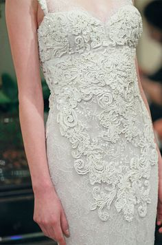 A gorgeous textured wedding dress from Badgley Mischka, Fall 2013. Click to see the full dress!