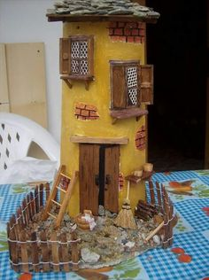 """Like the rough and tumble look of the yard and the bricks showing through the DIY """"finish"""" of the walls.and it could still be Pink! Brick Show, Mini Craft, Ceramic Houses, Polymer Clay Crafts, Decorative Tile, Miniature Fairy Gardens, Tile Art, Fairy Houses, Decoupage"""