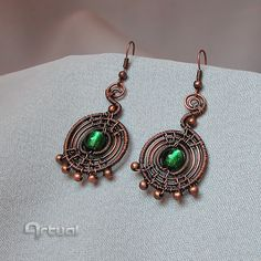 Wire wrapped dangle earrings with green dichroic glass by Artual