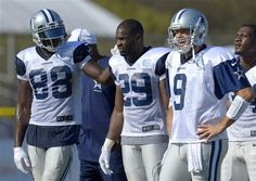 Dallas Cowboys, from left, Dez Bryant, DeMarco Murray and Tony Romo look on during NFL football training camp, Friday, July 26, 2013, in Oxnard, Calif. (AP Photo/Mark J. Terrill)