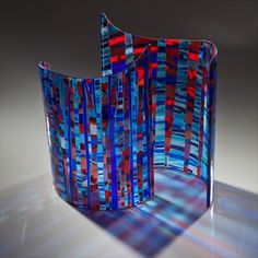 Varda Avnisan Art Glass Design Studio offers one of kind art glass pieces, which include vessels, sculptures, as well as architectural design work. Varda's work is unique in her approach as glass as a language: its luminescence and transparency, volume and weight, and qualities of light and shadow are elements she uses in translating the visual and sensual realities around her.