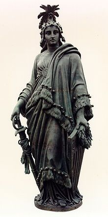 Praxidike - the statue atop the US Capitol Building in Washington, DC.  Which I like.  Praxidike (Justice) should be watching over Congress.  Praxidike was an epithet for Persephone in the Orphic Hymns