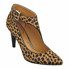 "As seen in the September issue of Better Homes & Gardens.....Pointy toe pump with buckle detail on a 3"" heel"