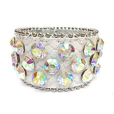 "This leather cuff is constructed of genuine leather, has a snap-on feature and is accented in rhinestones all the way around. Material: Genuine Leather - Size: 8.5"" Long x 2"" Wide - Color: White $39.99"