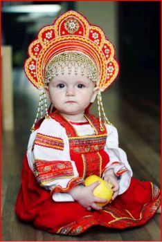Young girl in traditional Russian folk costume