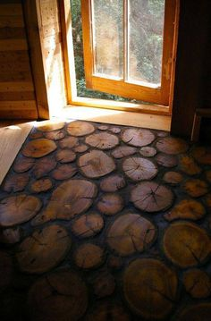 log slice floor - sealed and epoxy grouted - found on - A Gathering For Kindred Souls looking to live off The Grid - original source unknown - love how this looks!