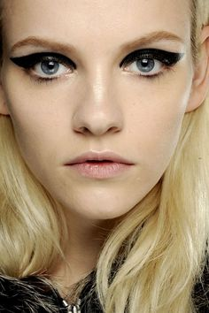 LANVIN - Dramatic winged liner provided the beauty focus, Vogue.