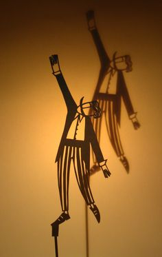 Su Owen: Shadow Puppet //www.etsy.com/listing/106931101/circus-man-shadow-puppet-paper-cut