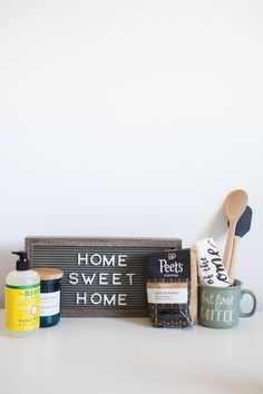 Instantly become the coolest friend ever by prepping one of these fun and welcoming moving essentials kits for a friend who's moving! It's got some necessities and some niceties to welcome someone home and get them through the stress of #MovingDay. #LifeStorageMoving #HousewarmingGifts #housewarming