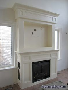 Take a look at our Picture Gallery of most recent projects includes crown moulding, trimwork, coffered ceiling, wainscoting, pot lights installations and more in Toronto and GTA area! Tv Above Fireplace, Fireplace Frame, Fireplace Built Ins, White Fireplace, Farmhouse Fireplace, Faux Fireplace, Fireplace Remodel, Fireplace Surrounds, Fireplace Design