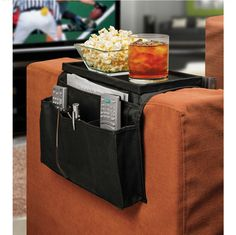The Ideas In Motion 6 Pocket Sofa Couch Arm Rest Organizer with Table Top provides a unique way to store all your essentials in an organized manner while watchi
