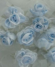 Thank you for stopping by my store today.  Up for your consideration is one 36 piece set of wired Rose Flowers. They are fashioned with Satin and Organza fabric in a beautiful shade of LIGHT BLUE. Delicate stamens are mixed between the petals and a Satin rolled rosette embellishes the center of the rose. This Beautiful Satin Rose is nestled in Delicate Organza petals and Green leaves. There are 3 Roses on a wired bunch and you will receive 12 bunches, 36 Roses total. Each rose has a separate…