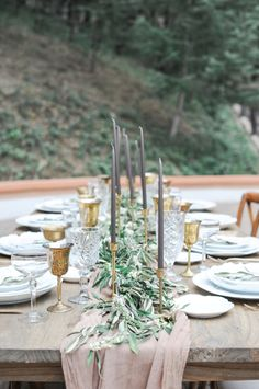 A Dusty Pink Table Runner With Olive Leaves And Eucalyptus And Grey Candles In Gold Candle Holders Wedding Table Layouts, Wedding Table Decorations, Wedding Table Settings, Wedding Centerpieces, Wedding Tables, Wedding Ceremony, Quinceanera Centerpieces, Table Centerpieces, Wedding Events
