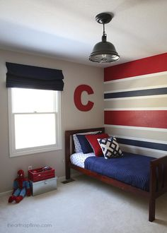 Today I'll be sharing the room makeover for my son's superhero room! It's finally done! I feel like just yesterday I was showing you his nursery. I was thrilled when Sherwin-Williams asked me to be Bedroom Red, Kids Bedroom, Bedroom Decor, Bedroom Ideas, Bedroom Designs, Modern Bedroom, Bedroom Small, Trendy Bedroom, Striped Walls Bedroom