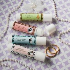 SET OF 40 PERSONALIZED LIP BALM FAVORS ___________________________________  Sometimes little favors pack a big punch and this luscious lip balm surely fits into that category. Each vanilla-flavored lip balm tube measures 2 ¾ x 5/8 and features a twist bottom to raise the balm as you
