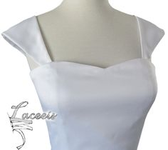 Cool way to add cap sleeves to a strapless dress. The cap sleeves are attached by sewing a button inside the dress. Great for wedding dresses, but they have 18 different colors to choose from!