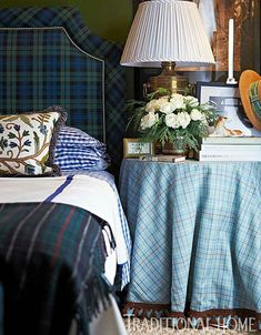Welcome tartan in the bedroom. - love the contrast of it & the plaid skirted table! Great looking room!