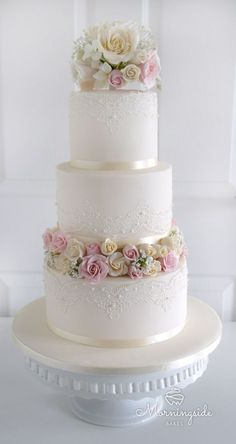3 tier wedding cake with edible lace, sugar rose bouquet and rose buds separator.
