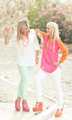 Perfect for a spring sister picture.  Flowy white blouse with mint skinny jeans pink wedges and orange bead necklace. Pink and orange color block shirt with white skinny jeans and orange wedges.