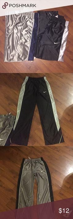 Bundle Nike pants 2 Nike pants good condition. The gray one size xl. Black one size large Nike Bottoms Sweatpants & Joggers